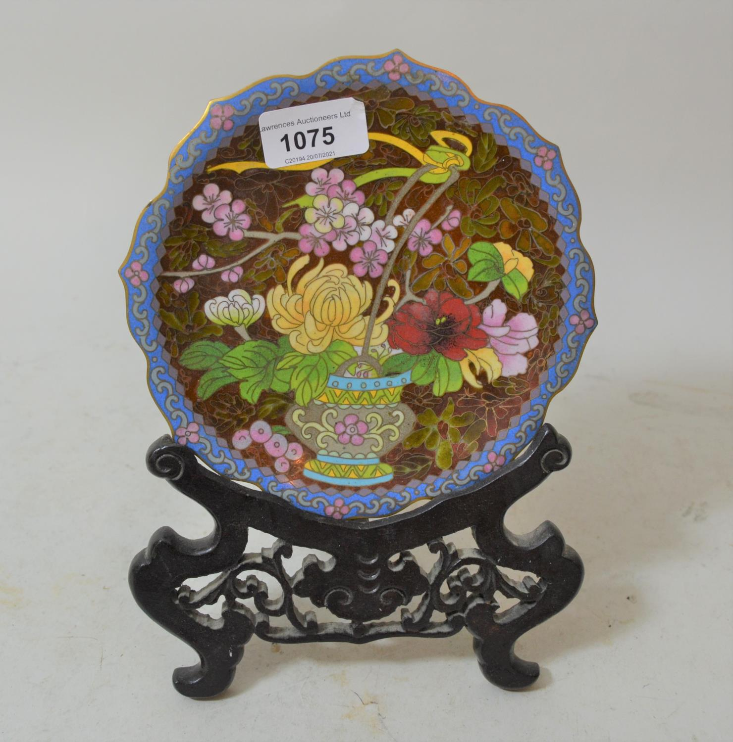 Chinese circular floral decorated cloisonne plate on a wooden stand