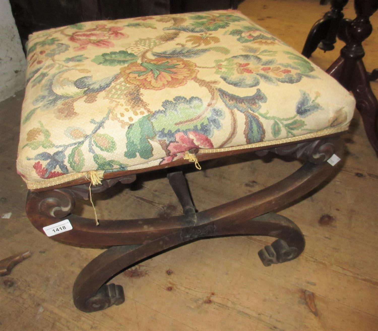 19th Century mahogany crossover stool having overstuffed seat with floral upholstery, carved details