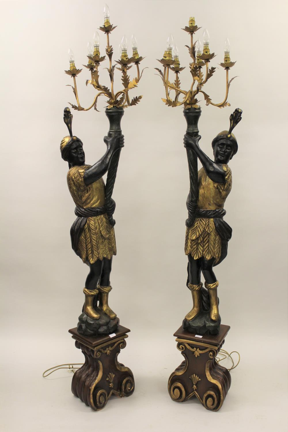 Pair of reproduction carved, gilded and ebonised lamp standards in the form of Venetian blackamoor
