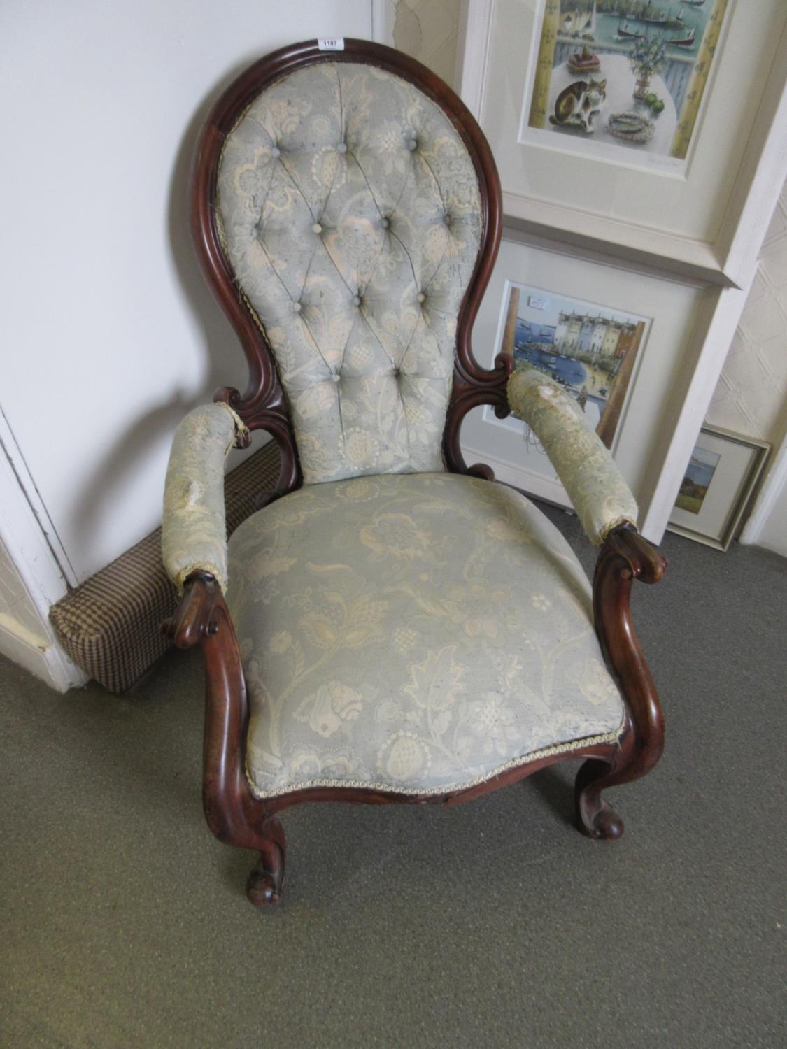 Victorian walnut button upholstered spoon back armchair having C-scroll carved arm supports and legs