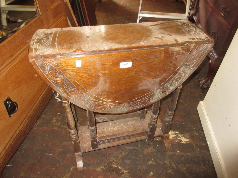 Small carved oak oval gateleg table