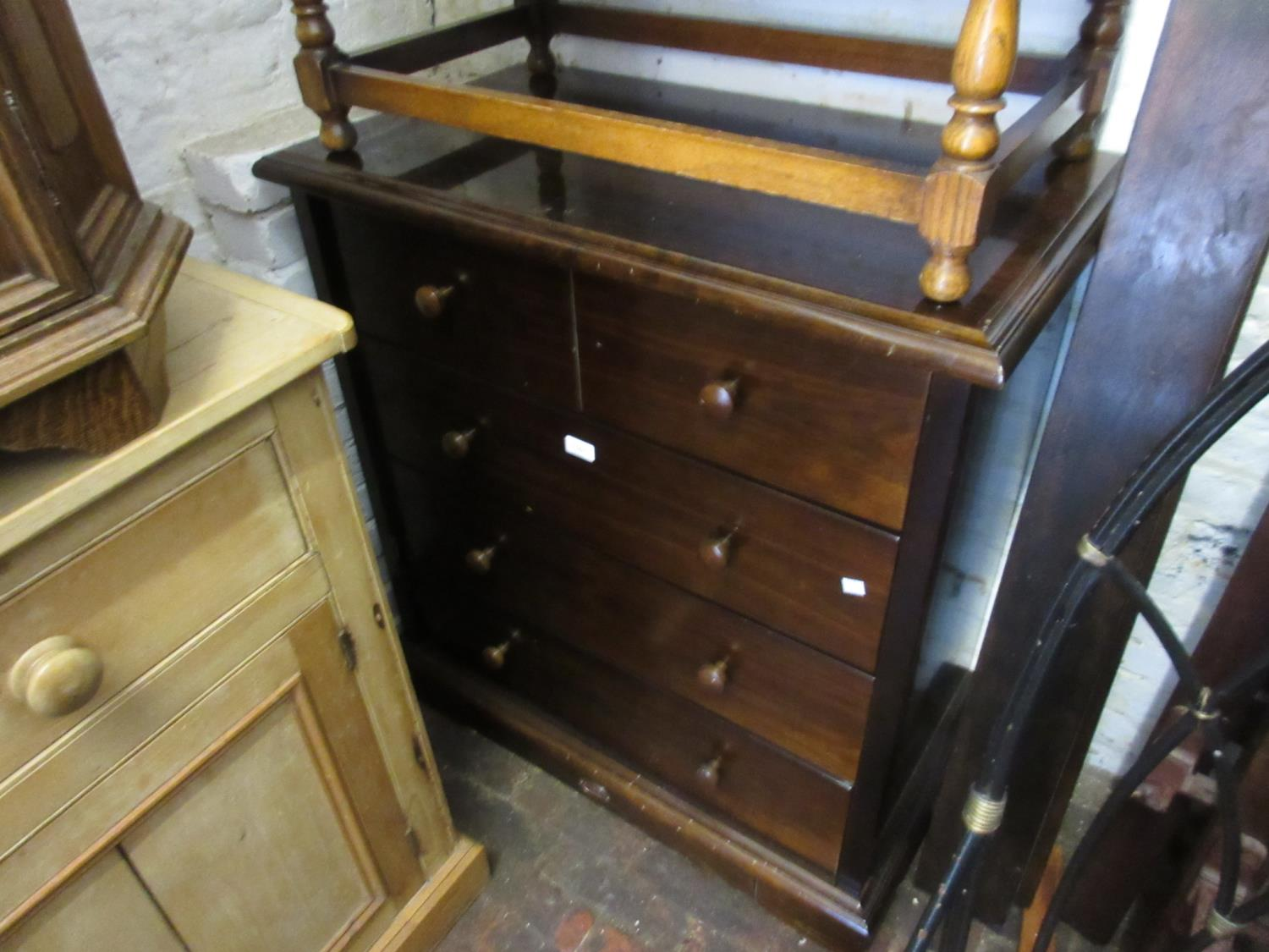 Reproduction mahogany straight front chest of four long drawers on a plinth base