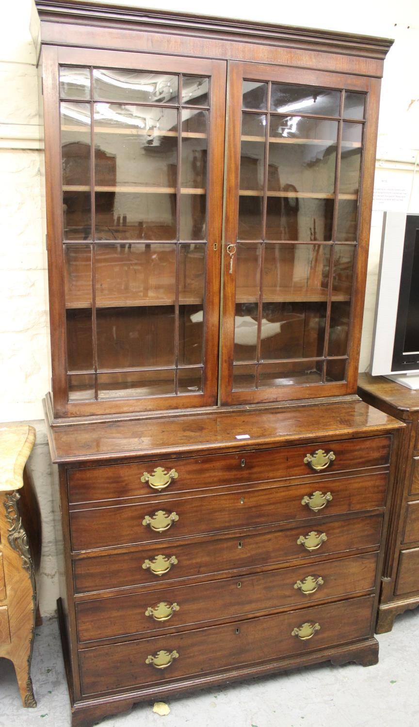 George III mahogany secretaire bookcase, the moulded cornice above a pair of bar glazed doors
