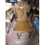Victorian oak hall chair with an armorial back together with a box seat piano stool and an