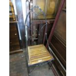 Modern heavy wrought iron Gothic style side chair with wooden slatted seat, 49ins high x 20ins