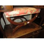 20th Century X-frame stool with overstuffed floral seat, turned stretchers and gilt metal mounts,