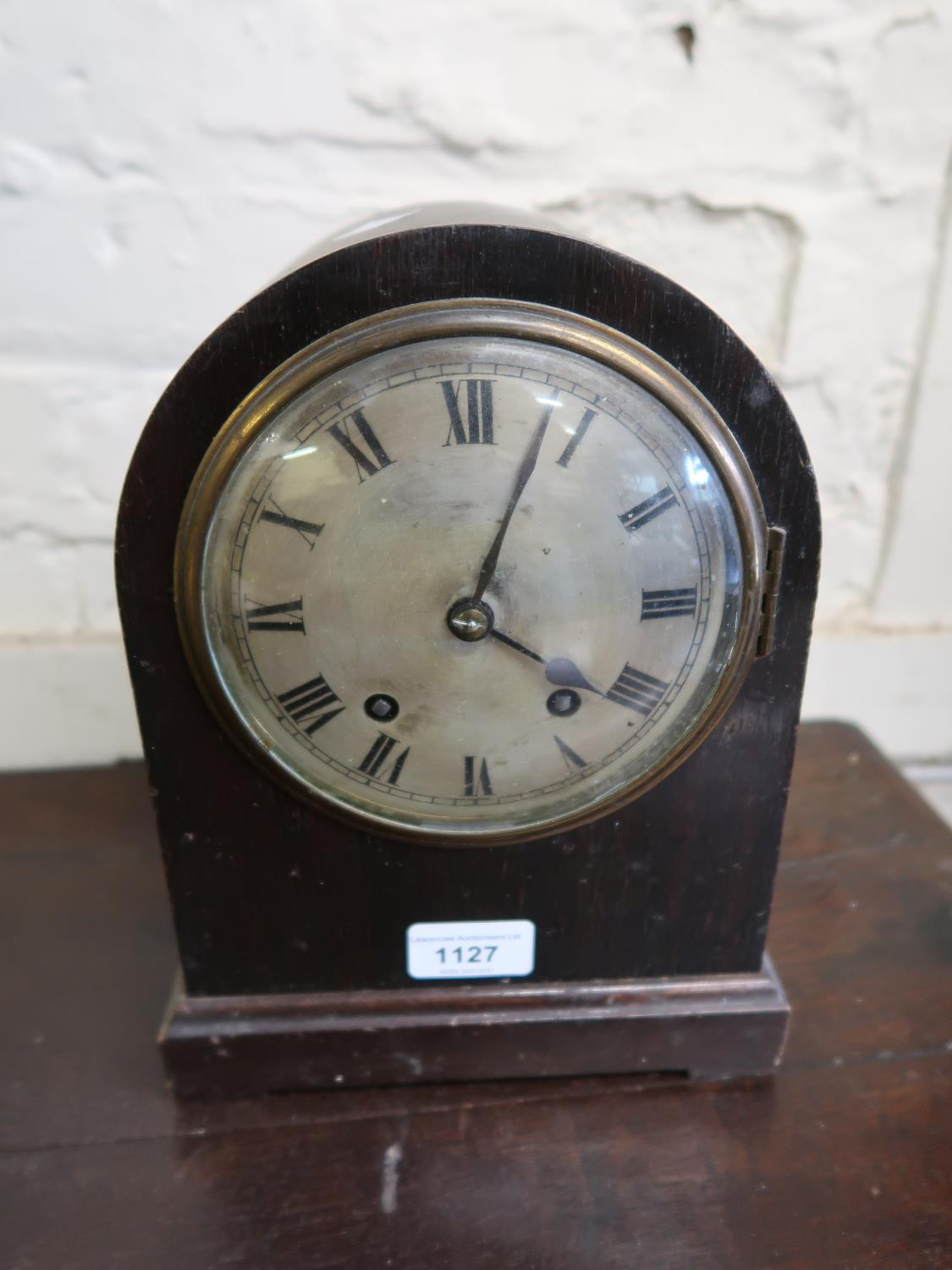 Early 20th Century mahogany dome shaped mantel clock with a circular silvered dial, Roman numerals