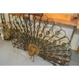 Mid 20th Century wrought iron and parcel gilt fire guard in the form of a peacock, 48ins x 31.5ins