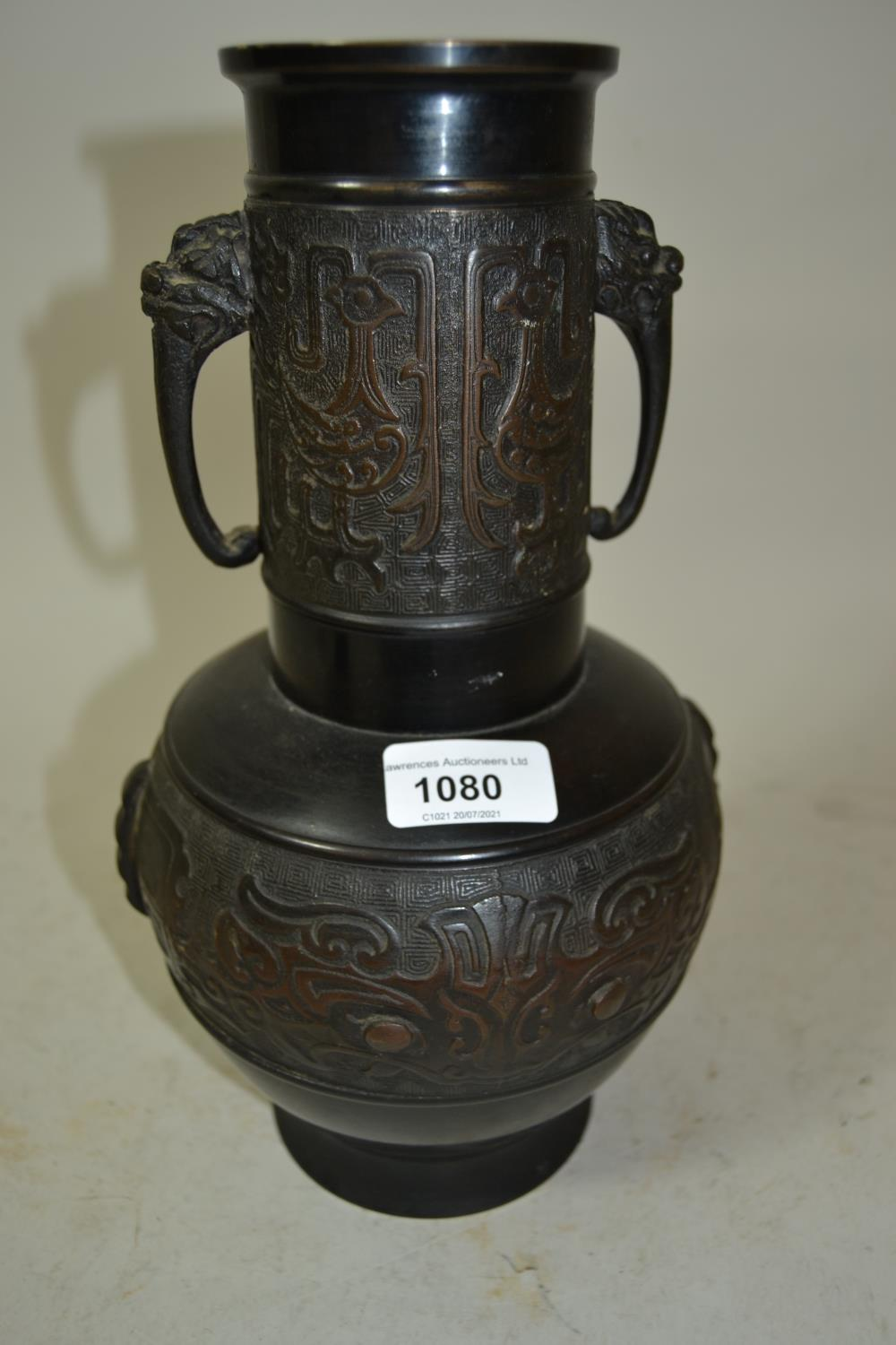 Japanese dark patinated bronze vase with cylindrical neck above a baluster form body decorated