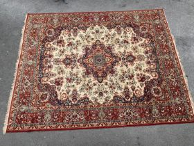 Machine woven carpet of Persian design with red ground and borders, 14ft x 10ft approximately