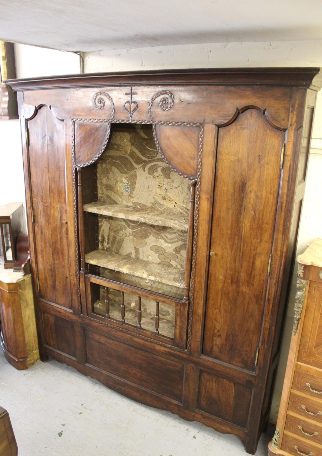 Large 19th Century French fruitwood shallow side cabinet, the moulded cornice above a carved frieze,