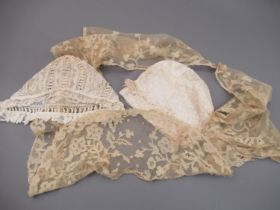 Two antique lace childrens bonnets together with a lace collar