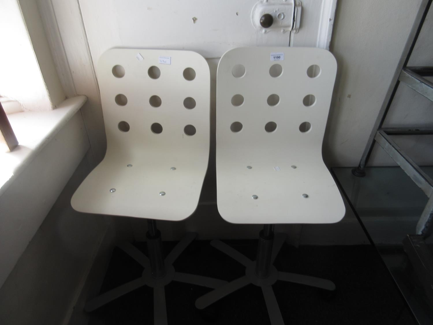 Pair of contemporary white painted laminate and metal swivel chairs