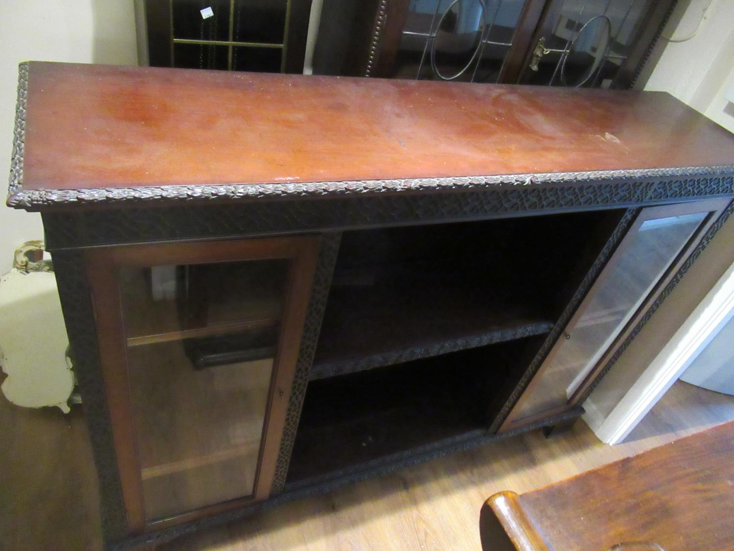 Mahogany bookcase with blind fret over two glass doors and open shelves on block feet