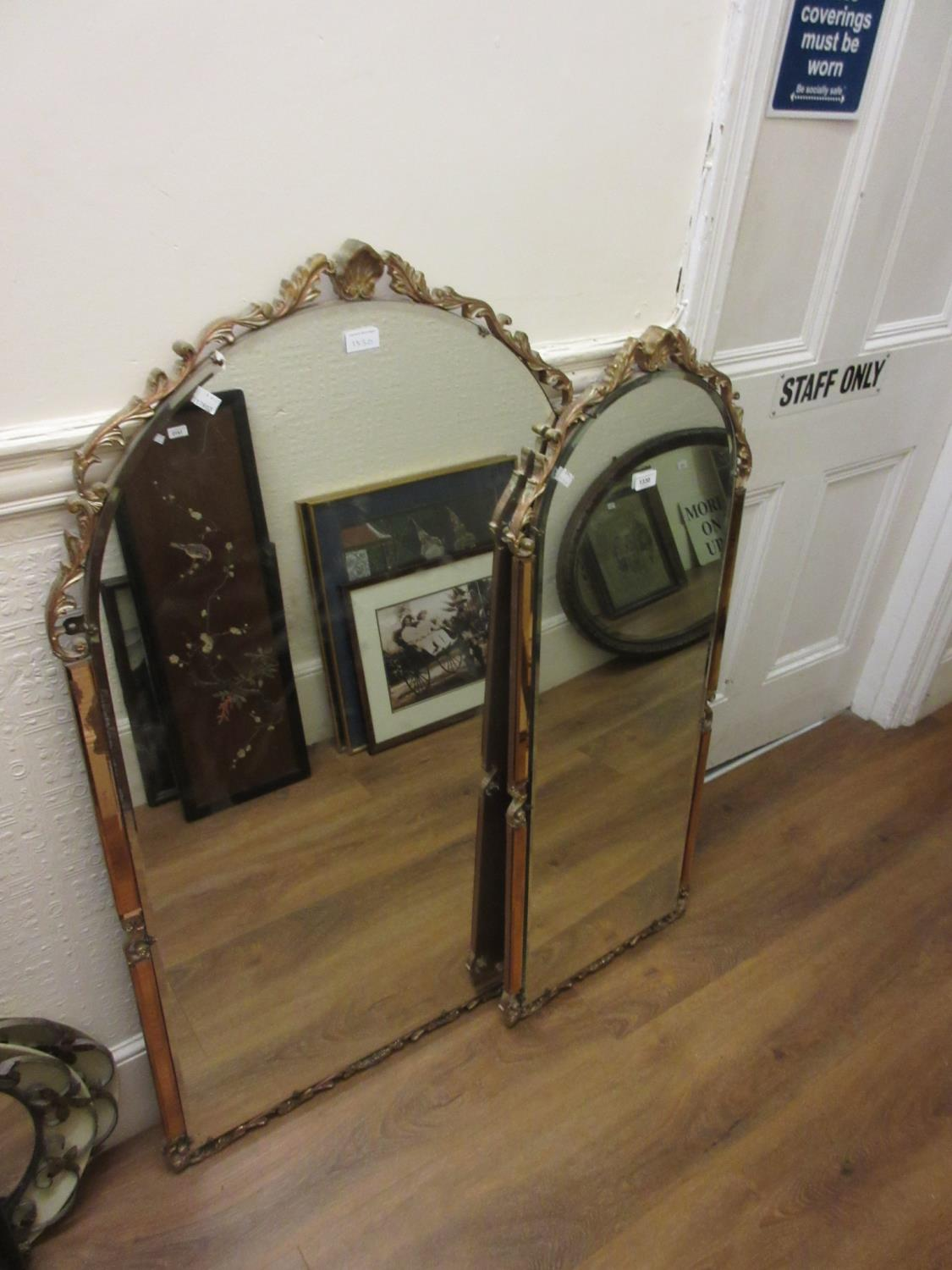 Two reproduction Venetian style arched top wall mirrors, the largest 49ins x 27ins