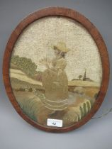 Small late 18th / early 19th Century Berlin silkwork picture of a girl in a landscape, oval mahogany