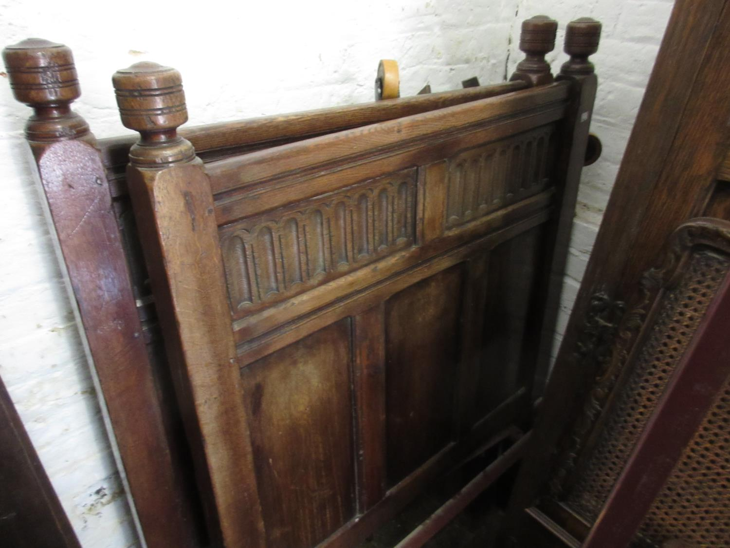 Pair of reproduction panelled oak single bedsteads in 17th Century style Headboards - 36.5ins wide x