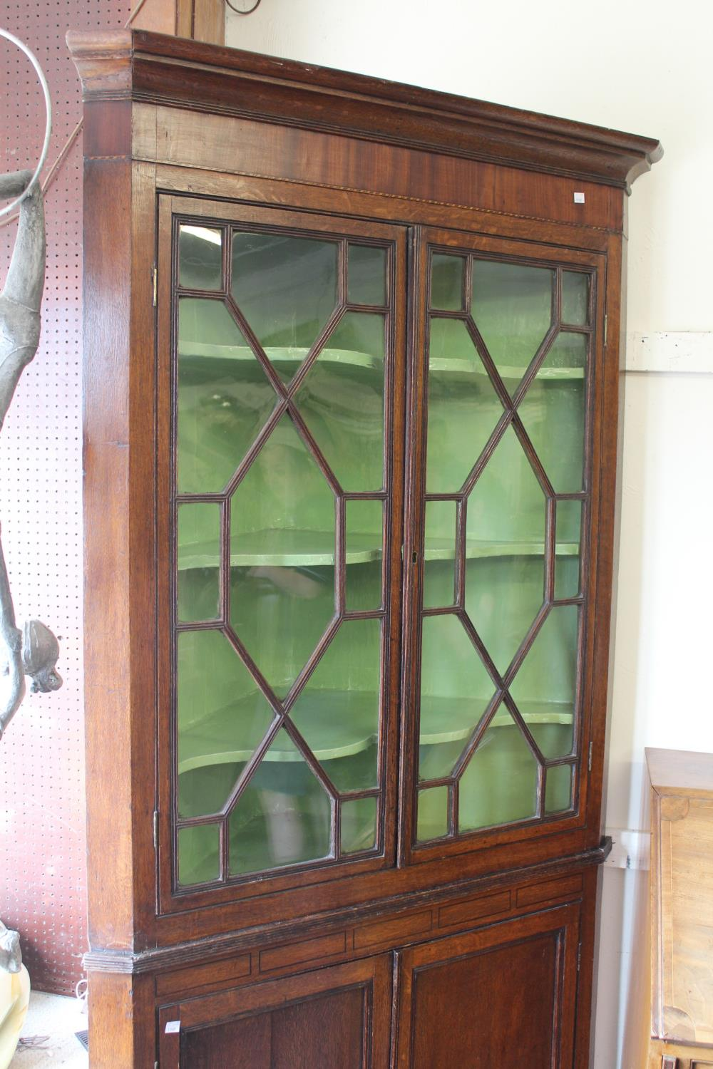 George III oak standing corner cabinet with a moulded cornice above a pair of astragal glazed doors, - Image 2 of 5