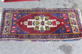 Small Turkish rug together with a small machine made Bokhara rug