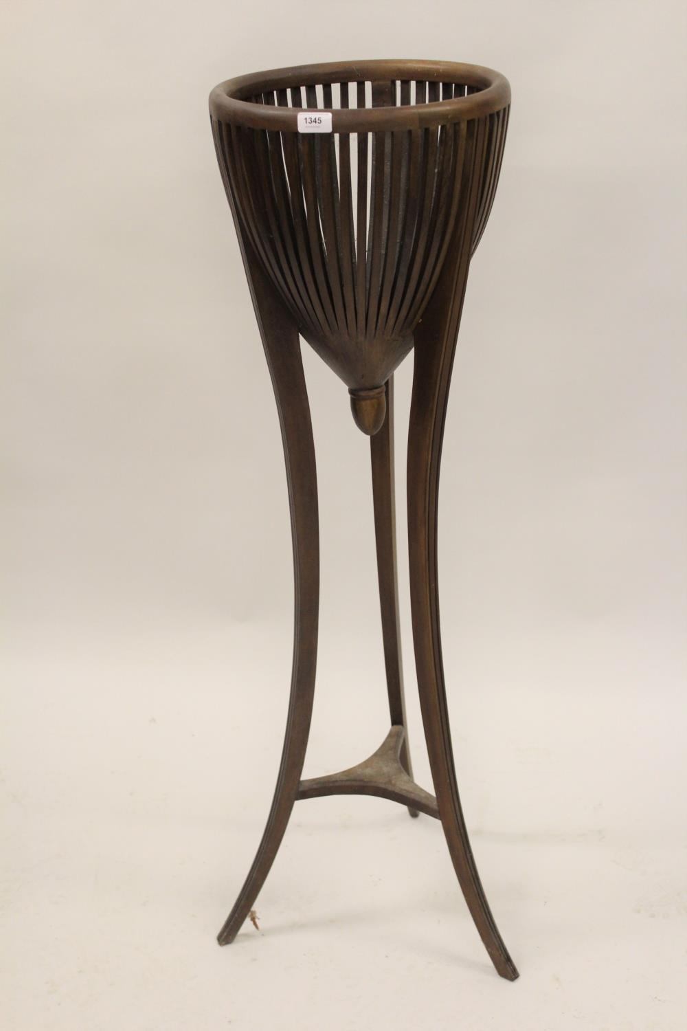 Edwardian mahogany jardiniere stand with basket top