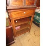 Early 20th Century mahogany display cabinet with a hinged lid above a bevelled glass door raised