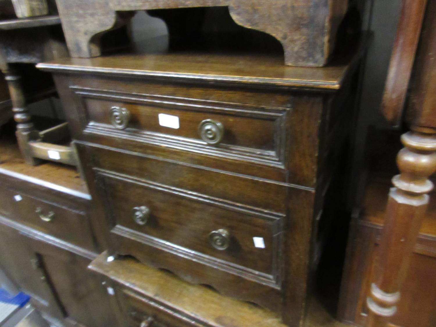 Small reproduction oak two drawer chest with knob handles and bracket feet, together with a small