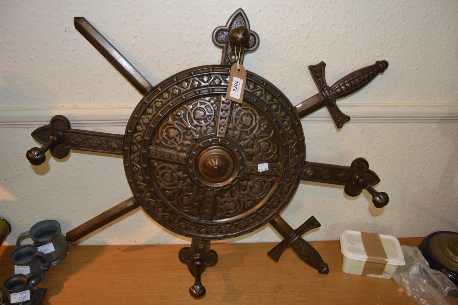 Unusual brown patinated iron coat rack in the form of a shield and crossed swords