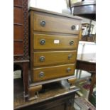 Small reproduction mahogany four drawer chest together with a mahogany shield shaped mirror and a