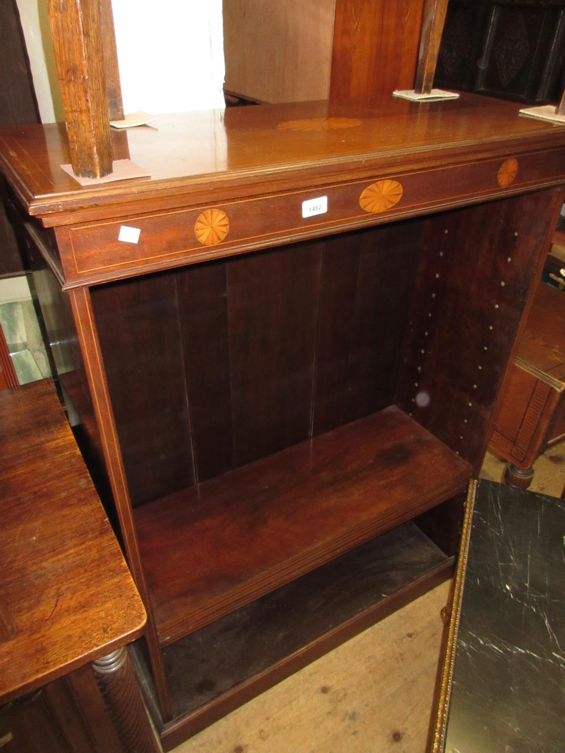 Edwardian mahogany line and shell inlaid open book case, having three adjustable shelves on a plinth
