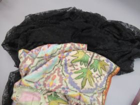 Ladies black lace shawl together with a printed shawl