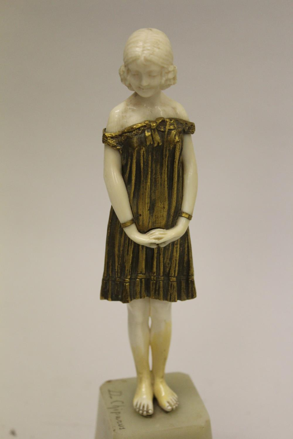 Dimitri Chiparus, small gilt bronze and carved ivory figure of a standing girl on an onyx plinth - Image 2 of 8