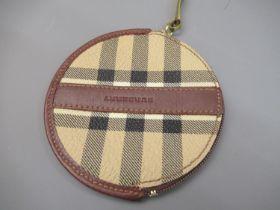 Circular Burberry purse
