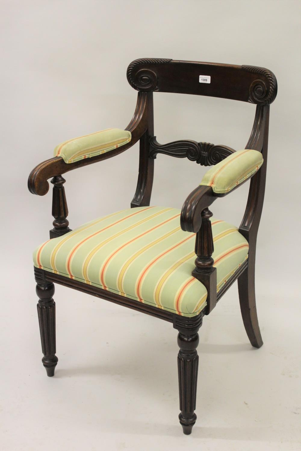 William IV mahogany open armchair, the carved and moulded rail back above moulded and padded arms,
