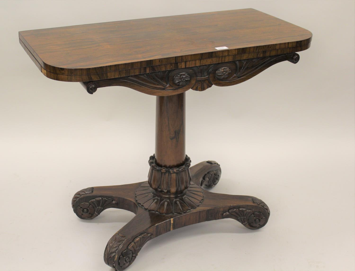 William IV rosewood fold-over card table with tulip carved column support and quadruped base,