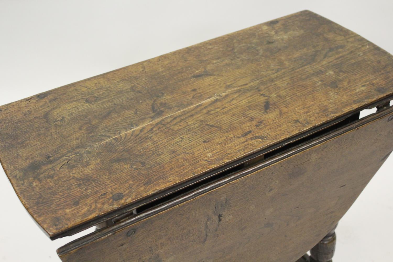 Charles II small oak drop leaf stool / table, circa 1680, the oval hinged top raised on turned - Image 2 of 9