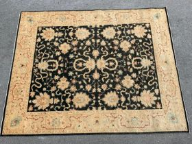 Good quality modern Afghan Ziegler carpet with a typical all-over design on a black ground with