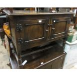 Reproduction oak side cabinet, the plank top above two panel doors on turned supports with