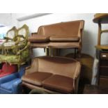 Pair of mid 20th Century French salon sofas, the moulded frames with pink fabric upholstery on