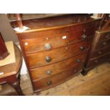 Victorian mahogany bow fronted chest of two short and three long drawers with knob handles, raised