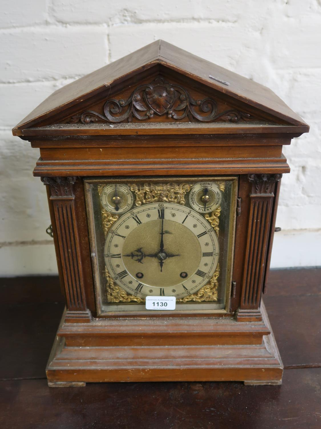 Late 19th Century Continental walnut mantel clock, the gilded and silvered dial with Roman and