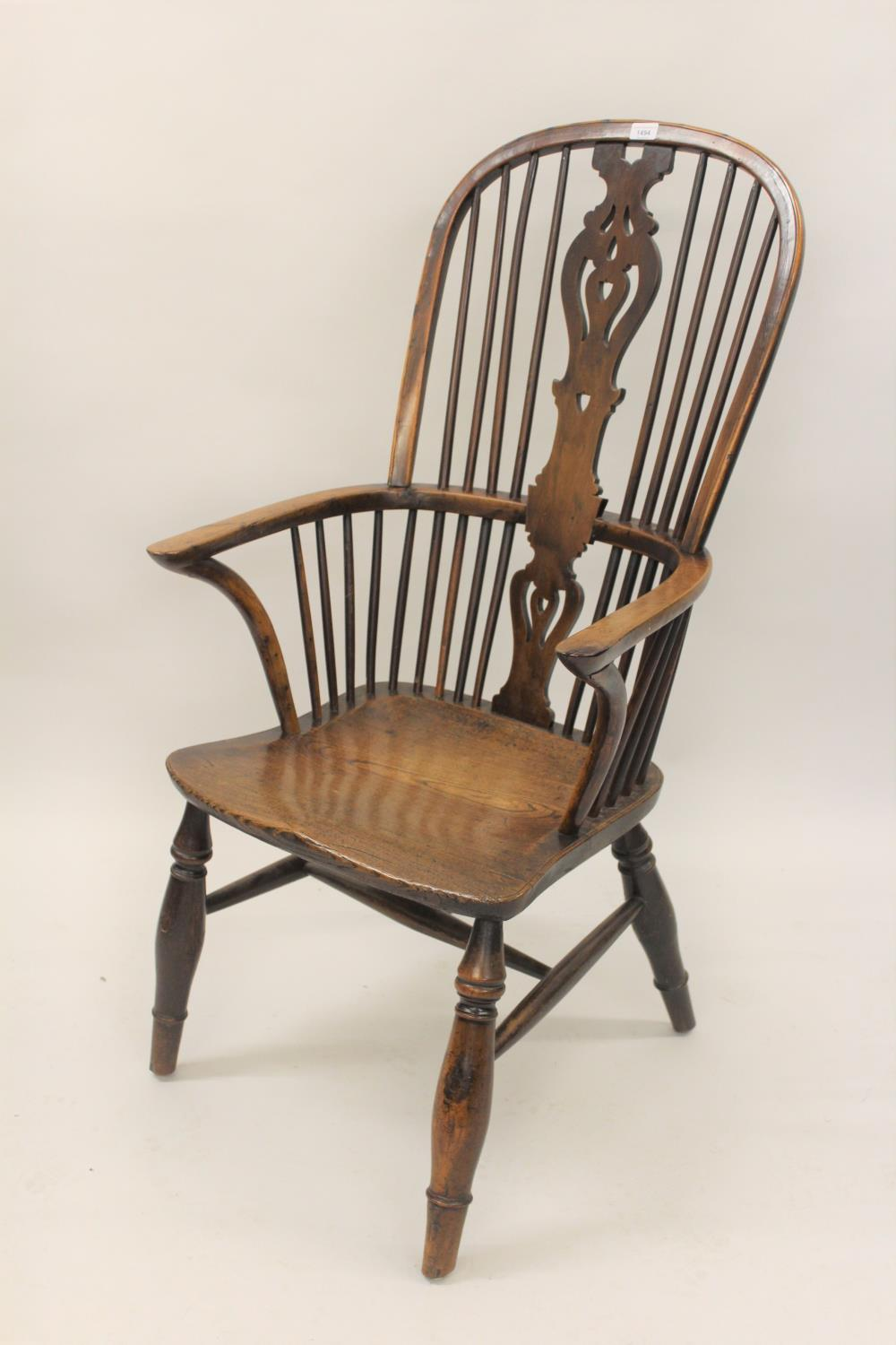 Large 19th Century yew and elm Windsor chair, the high hoop, stick and splat back above a carved