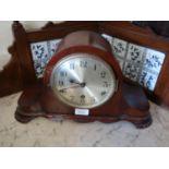 20th Century mahogany dome shaped mantel clock having circular silvered dial with three train