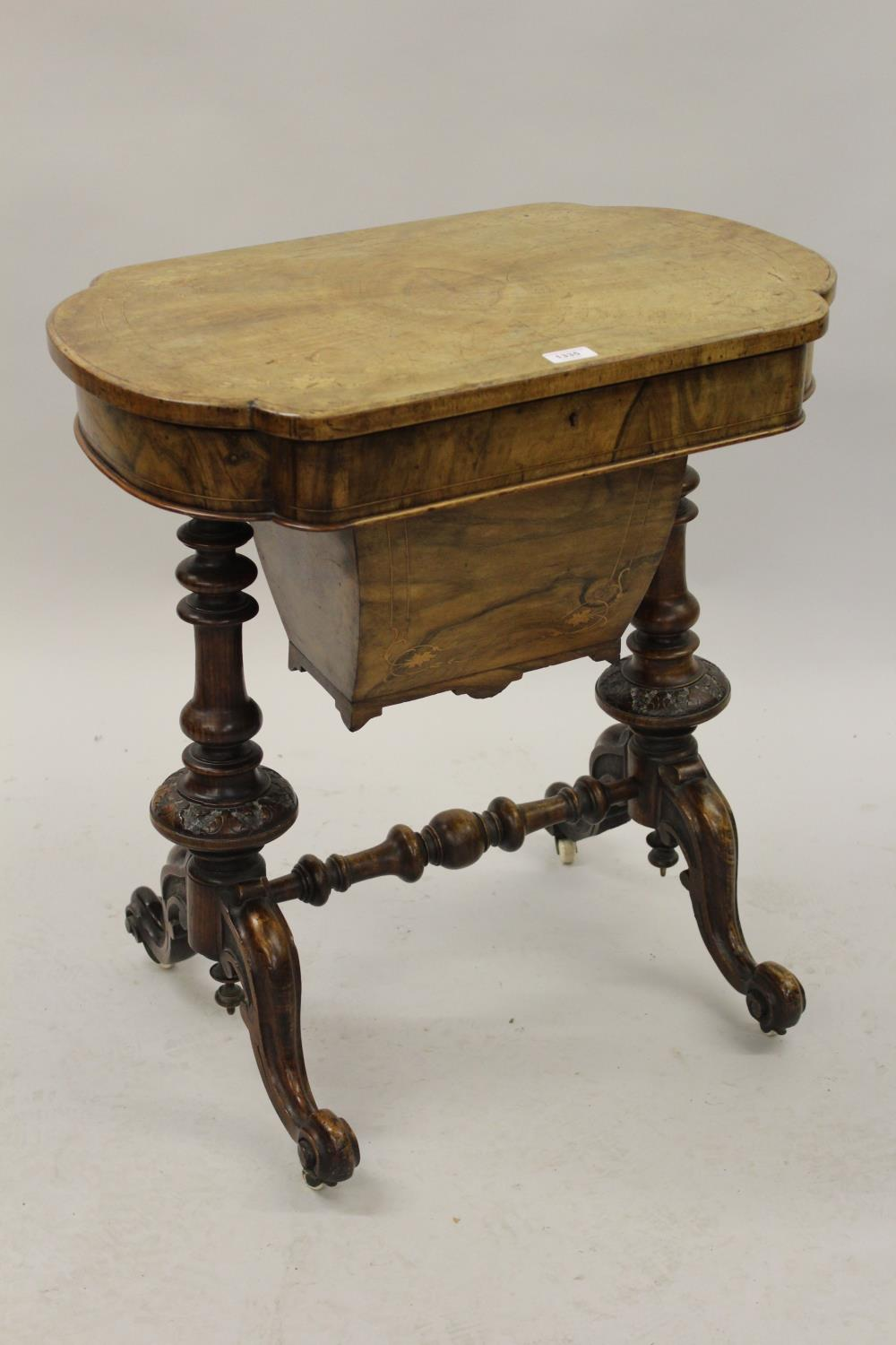 Victorian figured walnut marquetry inlaid work table, the hinged top enclosing a fitted interior and