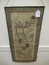Chinese silk needlework picture depicting children in a garden scene with pagoda, 26ins x 12ins
