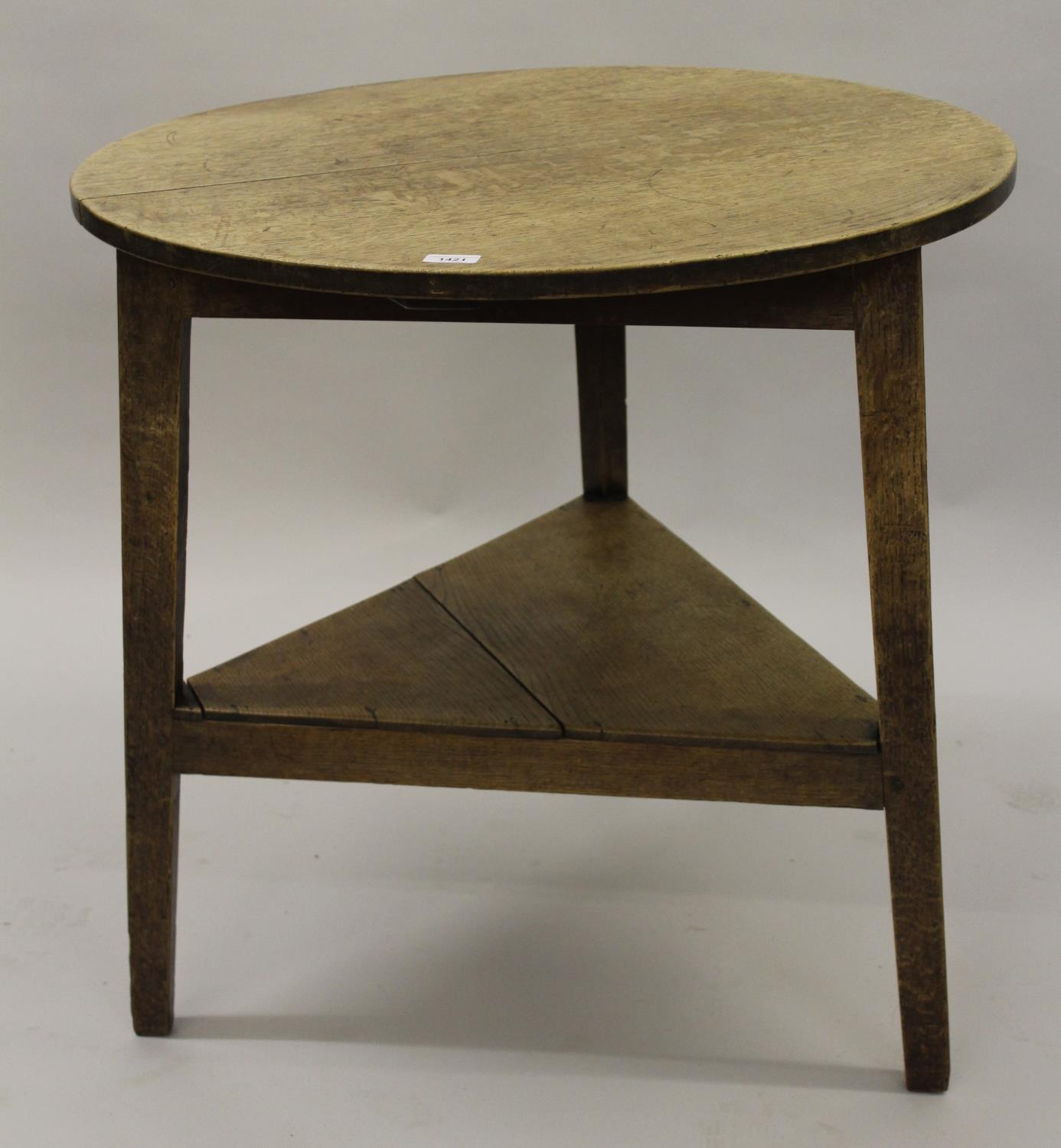 George III oak cricket table, the circular top raised on tapered supports with undertier, 30ins