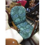 Mid 1970's Ercol armchair with a hoop and stick back, the cushions covered in William Morris