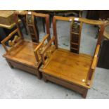 Pair of mid 20th Century Chinese low seat elbow chairs, 27ins high