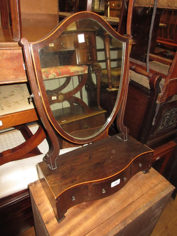 Mahogany and boxwood line inlaid shield shaped swing frame box toilet mirror with three drawer base,