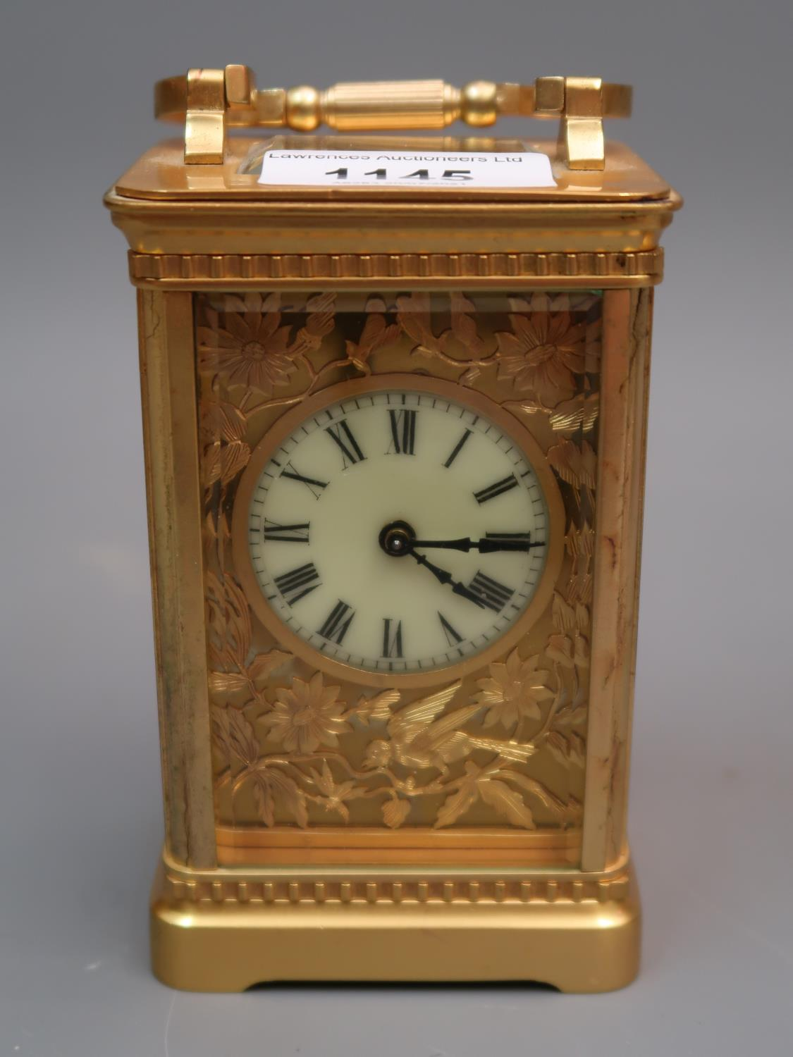 Early 20th Century gilt brass cased carriage clock, the enamel and gilt fretwork dial with Roman