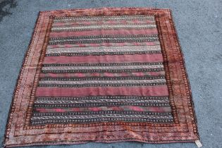 Small square Afghan rug with a Kelim centre panel and piled border, 4ft x 4ft 4ins approximately